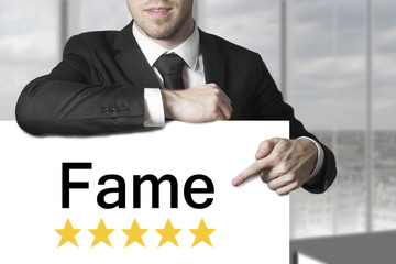 businessman pointing on sign fame