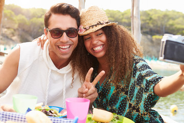 Young Couple Taking Selfie During Lunch Outdoors