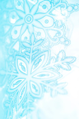 Winter snowflakes artistic background in  blue