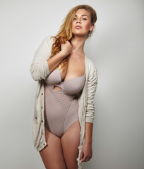 Curvy woman in underwear posing confidently