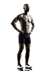 Wall Mural - young african shirtless muscular build man standing silhouette