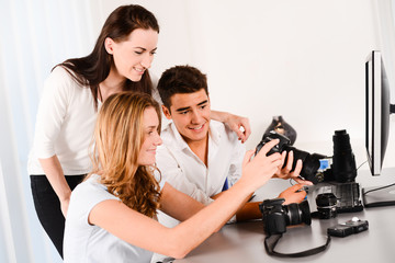 young student with teacher during photography editing course