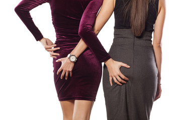 Two women hold each other for the buttocks