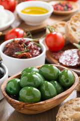 assorted Italian antipasti - olives, pickles and bread, close-up