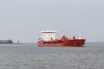 Cargo ship sailing in still water.