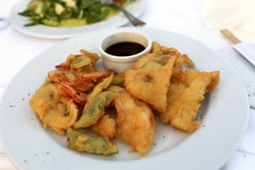 Plate with tempura shrimp and fish