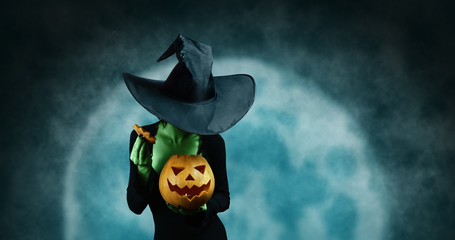 Green witch with pumpkin