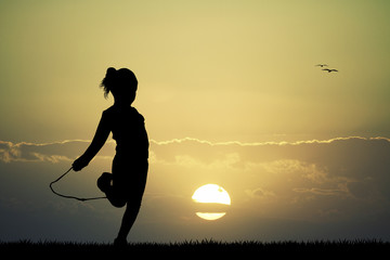 little girl jumping with the rope