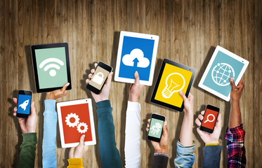 Hands Holding Digital Devices with Symbols
