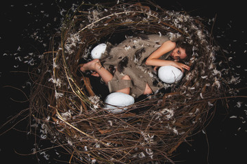 girl the chick in the nest with eggs