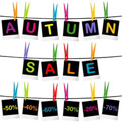 Autumn sale concept with photo frames hanging on clothespins