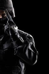 Fototapeta Spec ops soldier on black background