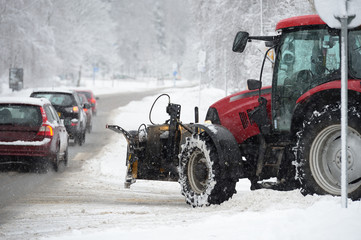 Snowplow and cars