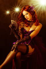 Beautiful young burlesque showgirl on stage.