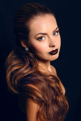 portrait of pretty brunette with bright makeup