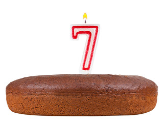 birthday cake with candles number 7 isolated on white background