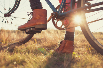 Female boots and vintage bike