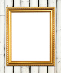 blank golden frame on colorful bamboo wall
