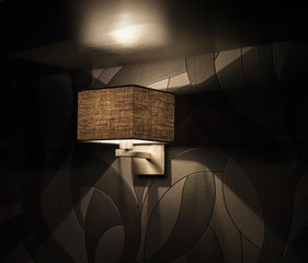 Electric lamp against a black wall