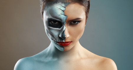 beautiful woman with makeup skeleton half