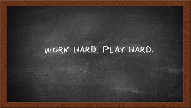 work hard play hard text on the chalkboard