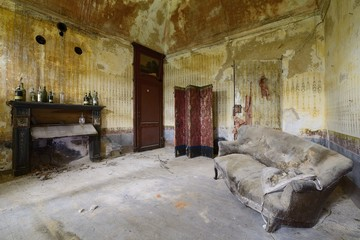 old abandoned living room with sofa