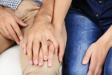 Loving couple holding hands close-up