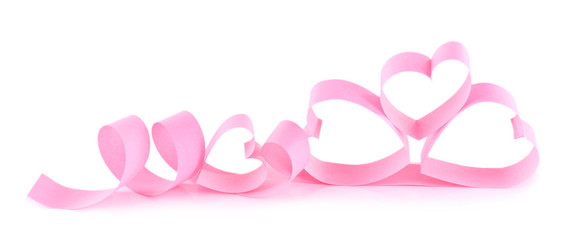 Heart shaped pink paper ribbon isolated on white