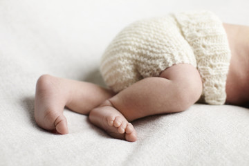 Newborn baby boy, low section in studio