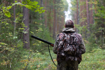 Acrylic Prints Hunting hunter in the forest
