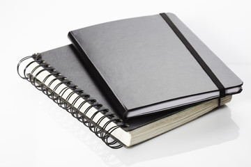 Notebook and diary on white background