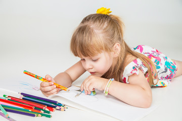 lovely girl drawing with colorful pencils