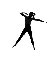 Silhouette of young woman dancing against white background