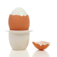 peeled egg in holder
