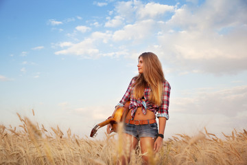 girl with guitar in the field