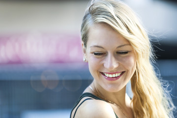 Young blonde woman laughing