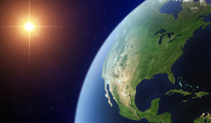 View of the North America from space lit by the sun. Wall mural