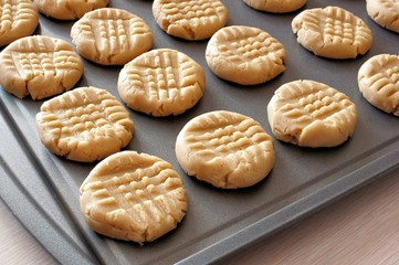 Poster Koekjes Peanut butter cookie dough on a baking sheet ready for the oven