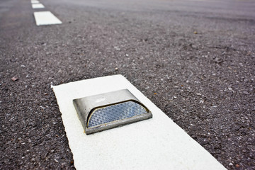 road stud with white reflector