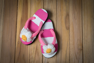 colorfull sandal with flower on wooden background