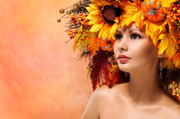 Autumn Woman with Fall Leaves. Portrait of Fashion Girl