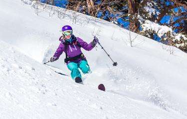 Off-piste skiing in deep snow