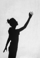 Girl stretching her hand toward the sky