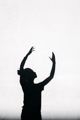 Girl stretching her hands toward the sky