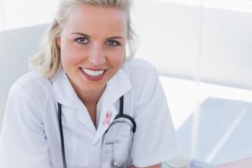 Composite image of portrait of a pretty nurse