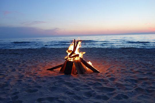 Campfire at dusk by the lake