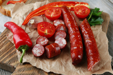 Fototapete - Smoked thin sausages and vegetables