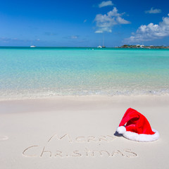 Merry Christmas written on tropical beach white sand with xmas
