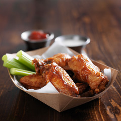 barbecue buffalo chicken wings with celery sticks