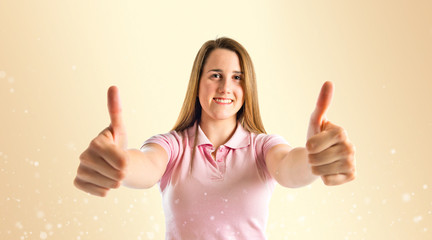 Young girl making Ok sign